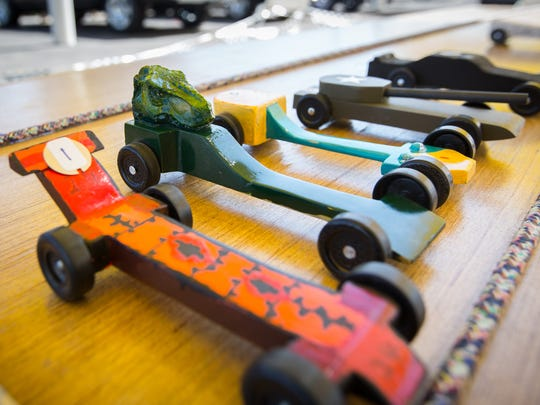 Pinewood derby race cars are lined up before the first race of the day during the Boy Scouts of America inaugural Father's Day 500 Pinewood Derby at a Sisbarro auto dealership on Boutz Rd, June 18, 2016.