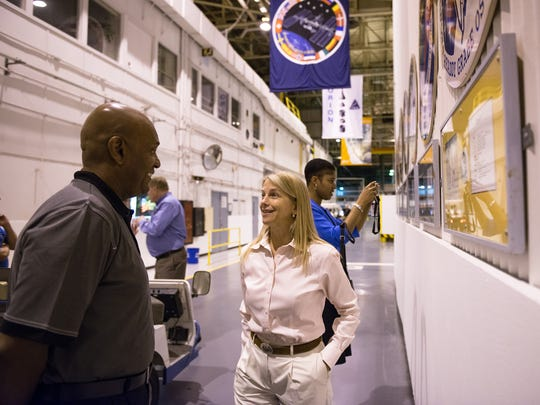 Helena native Dava Newman consults with NASA personnel.