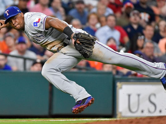 Texas Rangers third baseman Adrian Beltre attempts to throw out Houston Astros' Jose Altuve during the third inning of a baseball game, Wednesday, June 14, 2017, in Houston. Altuve was safe at first. (AP Photo/Eric Christian Smith)