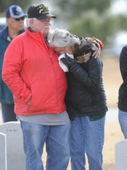Marianne Woffenden, right, is consoled by her husband, Clayton, during a wreath-laying ceremony at her brother's grave at the Texas State Veterans Cemetery in Abilene. Her  brother Concepcion Rocha, was a sergeant in the U.S. Army and served in Vietnam. He passed away in September at age 68. The Woffenden's were taking  part in an official wreath-laying ceremony Saturday, Dec. 17. 2016.