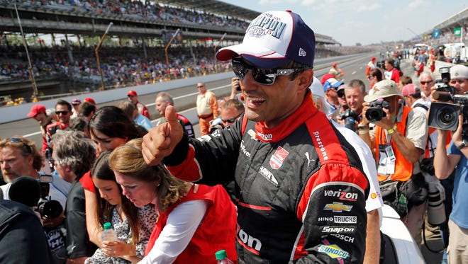 Juan Pablo Montoya, of Colombia, celebrates after winning the 99th running of the Indianapolis 500 auto race at Indianapolis Motor Speedway in Indianapolis, Sunday, May 24, 2015.