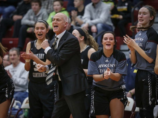 Ankeny Centennial girls basketball coach Scott DeJong and the bench cheer after a teammate hit a three-pointer against Ankeny High on Friday, Jan. 27, 2017, at Ankeny High School in Ankeny.