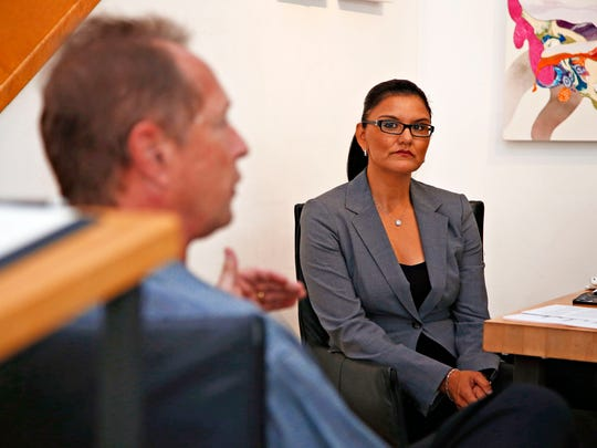 Veronica Graffius, president of the Scottsdale Gallery Association, and managing partner of the Calvin Charles Gallery listens to French Thompson, a board member of The Scottsdale Gallery Association during an interview in the Calvin Charles Gallery in Scottsdale on Sept. 18, 2015.