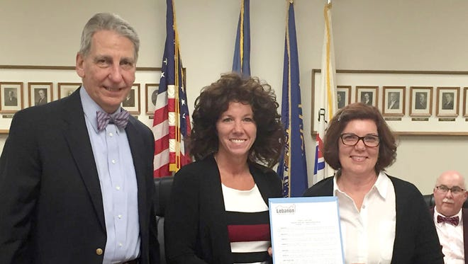 Lebanon Mayor Sherry Capello, center, and City Council Chairman Wiley Parker present a proclamation declaring Sept. 25-Oct. 1 National Adult Education and Family Literacy Week in Lebanon to Cheryl Heister, executive director of the Literacy Council of Lancaster-Lebanon.