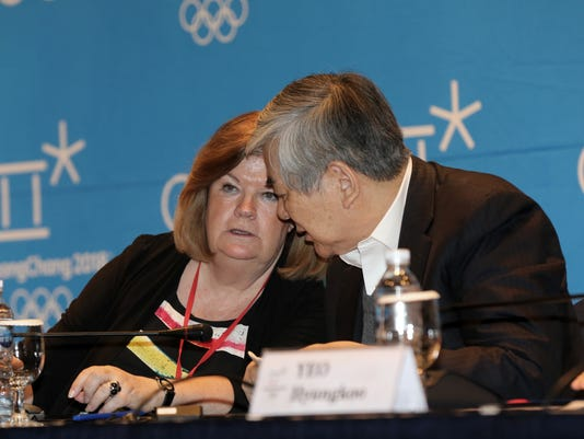 """Gunilla Lindberg, left, who chairs the IOC's coordination commission for the games, talks with Cho Yang-ho, president of the Pyeongchang 2018 Winter Olympics Organizing Committee, during a press conference in Gangneung, South Korea, Wednesday, March 16, 2016. South Korean organizers are """"moving in the right direction"""" but still have a """"lot of work to do"""" to prepare for the 2018 Winter Olympics in Pyeongchang, IOC officials said after their latest inspection visit. (Ryu Hyung-jae/Yonhap via AP) KOREA OUT"""