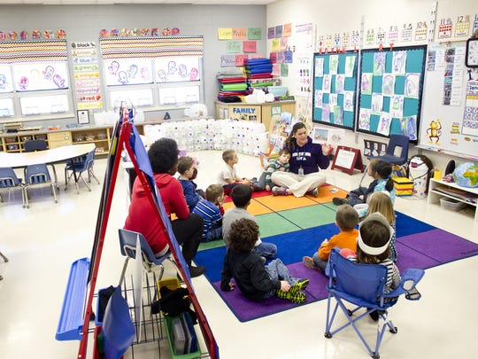 Erin Sheets teaches a preschool class at North Bend elementary in North Liberty, Iowa, on  Jan. 23, 2014.