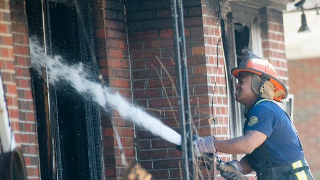 Montgomery firefighters continue to work a fatal structure fire scene after more than three hours on Monday, March 16, 2015, at 4383 Sunshine Drive in Montgomery, Ala. According to the Montgomery Police Department a child died in the fire.