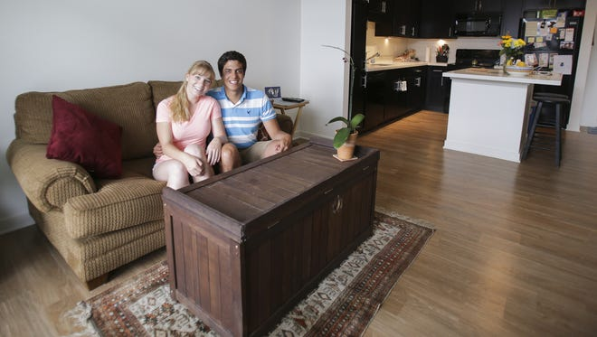 Katie Jackson and Gonzalo Castro in their living room inside their Circa apartment in Downtown Indianapolis on July 7, 2016.