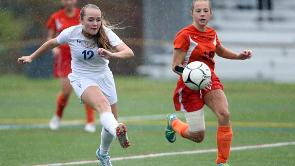 Haldane's Saoirse Maguire (12) works past Pawling's Morgan McCarthy (15) for a shot on goal during the girls Class C soccer finals at Arlington High School in LaGrangeville on Sunday, October 29, 2017.