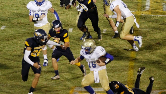 Brentwood High quarterback Carson Croy (16) scored two rushing touchdowns Friday to lead the Bruins to a 23-3 win over the Northeast Eagles.