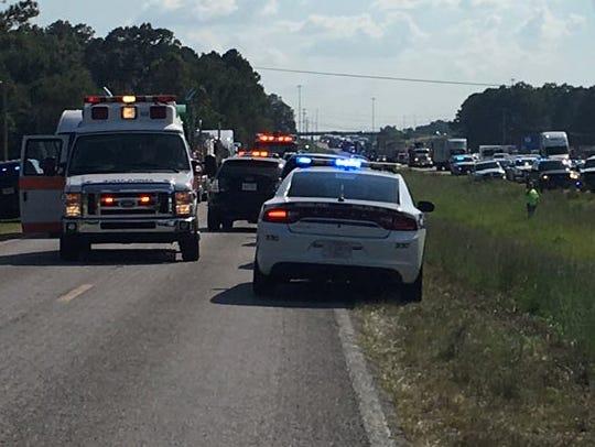 Law enforcement vehicles on a scene where three U.S.