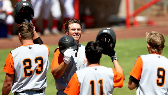 The Dirtbags' Sam Swenson (19) celebrates a run with his teammates in the DeMarini Dirtbags vs. BiMart Challengers baseball game in the first round of the American Legion Class AAA Tournament at Volcanoes Stadium in Keizer in Salem on Wednesday, July 27, 2016. The Dirtbags won 16-3 in seven innings.