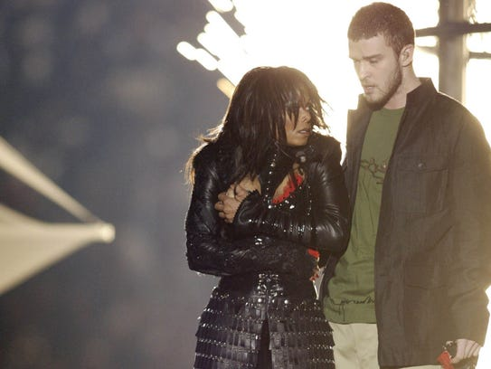 Janet Jackson covers up after Justin Timberlake ripped