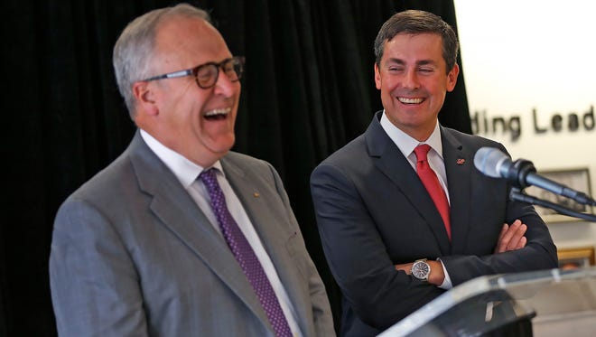 Eli Lilly and Co. CEO John Lechleiter, left, laughs with David Ricks, a senior vice president and president of Lilly Bio-Medicines, during a press conference Wednesday, July 27, 2016, announcing Lechleiter's retirement and Ricks' succession.