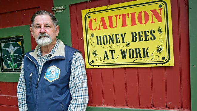 "Jeremy Barnes, from Springfield Township, stands outside the entrance to his shed that houses his A-J hive modeled after Slovenian bee hives. He believes it is the only A-J hive in Pennsylvania. Barnes recently won the 2017 Pennsylvania State Beekeepers Association ""Beekeeper of the Year"" award."