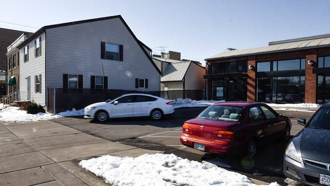 Developer Douglas Boser, Inventure Properties, wants to raze the triplex, left, to make space for drive-thru coffee shop and parking shown Monday, March 12, on the 200 block of Fifth Avenue South near St. Cloud City Hall.
