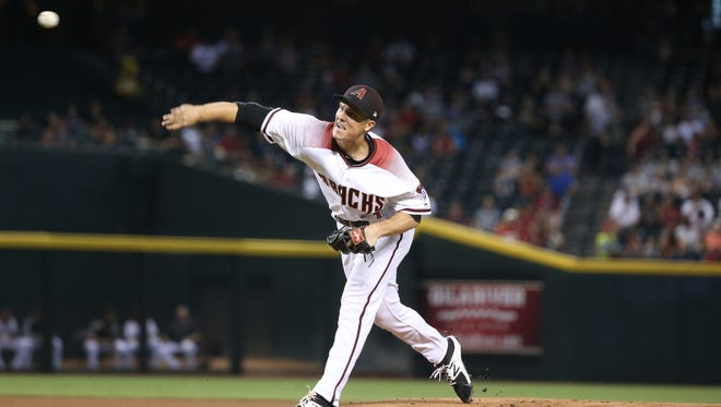 Diamondbacks Zack Greinke (21) pitches against the Braves in the first inning at Chase Field in Phoenix, Ariz. on July 24, 2017.