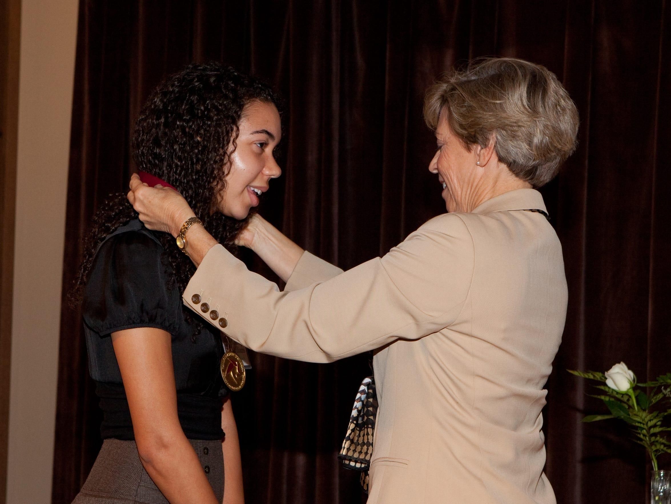 Kimora Williams, left, is presented the Garnet and