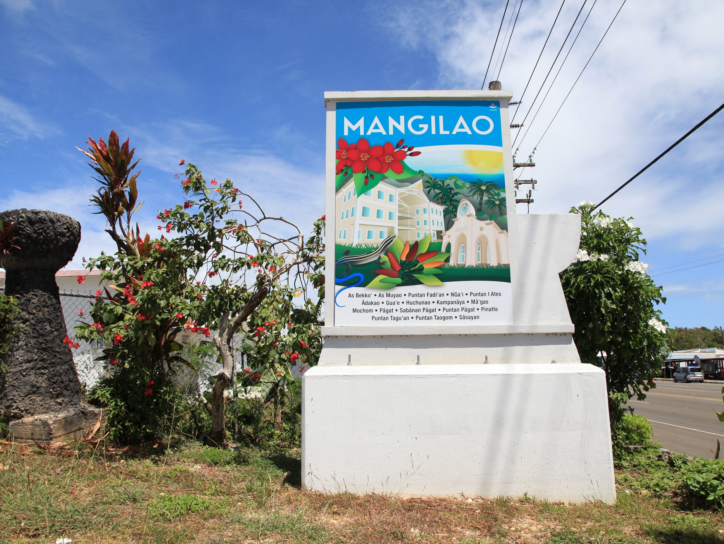A Mangilao village sign welcomes motorists travelling