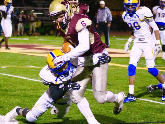 Governor Mifflin's Aaron Grill sheds a tackler during