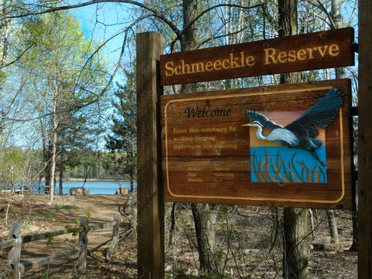 A great blue heron rising up off a sign welcoming visitors to the Schmeeckle Reserve on the University of Wisconsin-Stevens Point campus is the work of students at Cedar Signs at the reserve's visitor center.