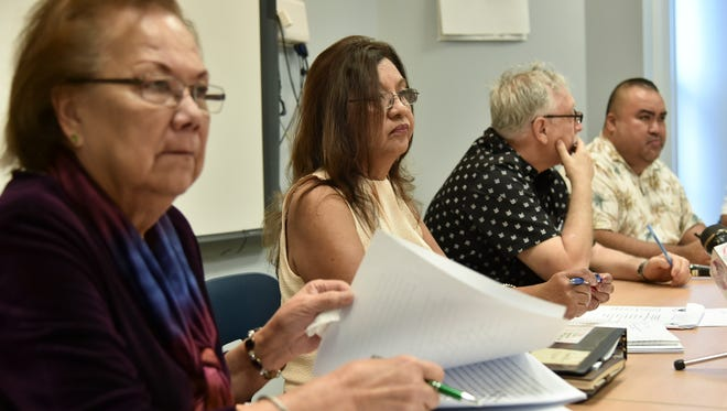 In this file photo, members of the Guam Education Board meet Tiyan on Oct. 13 2016.