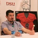 """Former CIA security contractor Kris """"Tanto"""" Paronto answers questions during a press conference Monday at Dixie State University."""