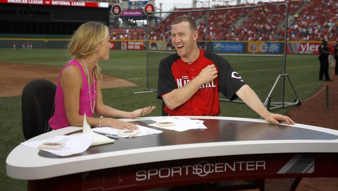 National League third baseman Todd Frazier of the Reds is interviewed by ESPN anchor Lindsay Czarniak ahead of  the 2015 MLB All-Star Game.
