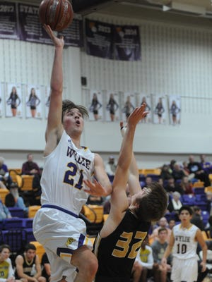 Wylie's Dylan Isenhower, left, shoots over Amarillo High's Nathan Betts during the second quarter in the championship game of the Catclaw Classic on Saturday, Dec. 9, 2017 at Bulldog Gym.