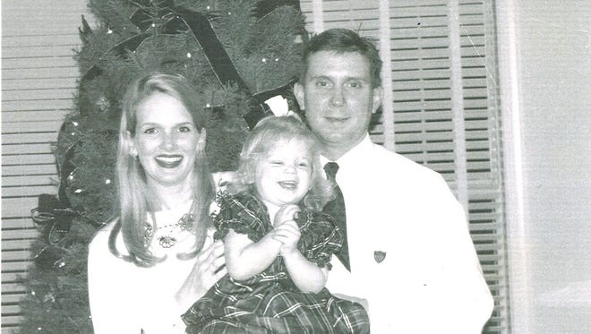 Mike Williams with his daughter, and wife Denise Williams, weeks before law enforcement now says he was murdered.