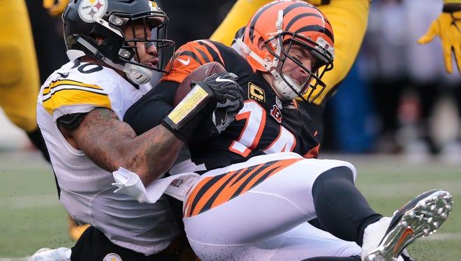 Cincinnati Bengals quarterback Andy Dalton (14) is sacked by Pittsburgh Steelers inside linebacker Ryan Shazier (50) in the third quarter during the Week 15 NFL game between the Pittsburgh Steelers and the Cincinnati Bengals, Sunday, Dec. 18, 2016, at Paul Brown Stadium in Cincinnati.