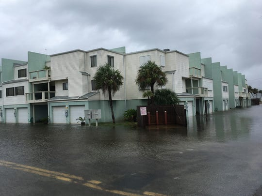 Floodwaters surround a condo in the aftermath of Tropical Storm Nate on Oct. 8, 2017, in Pensacola Beach, Fla.