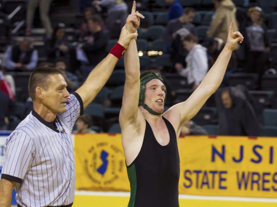 Alec Donovan (right) of Brick Memorial has his hand raised after winning the 145-pound title with a 1-0 victory at the NJSIAA Championships on Sunday. 145 - Alec Donovan of Brick Memorial vs Stephan Glasgow of Bound Brook  - NJSIAA State Wrestling Championships  on March 8, 2015 in Atlantic City, NJ.
