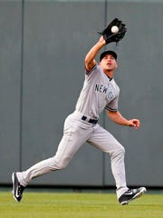 Yankees center fielder Jacoby Ellsbury (22) catches a fly ball in the first inning of the game against the Kansas City Royals at Kauffman Stadium on Tuesday, May 16, 2017.