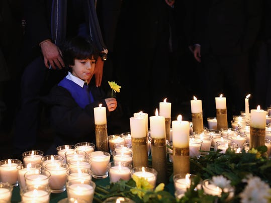 Candle Vigil In Memory Of The Victims Of The Taliban School Attack