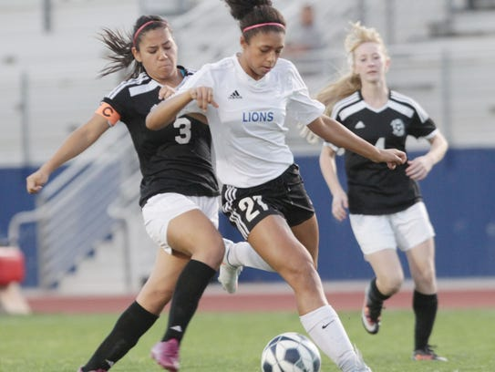 Cathedral City's Azalea Guanajuato tries to get a shot