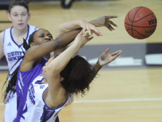 ACU's Taudenciah Oluoch battles a Central Arkansas