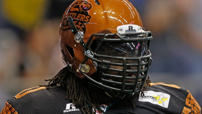 Rattlers' Marcus Pittman (70) waits for kick-off against the Thunder at the US Airways Center in Phoenix, AZ on April 18, 2015.