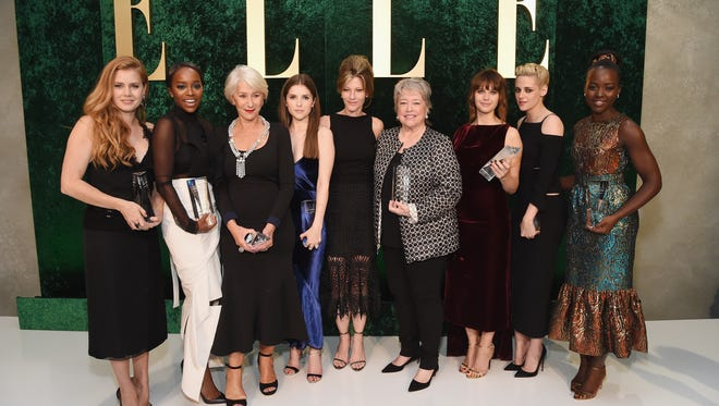 Honoree Amy Adams, honoree Aja Naomi King, honoree Helen Mirren, honoree Anna Kendrick, host Anthony Anderson, ELLE Editor-in-Chief Robbie Myers, honoree Kathy Bates, honoree Felicity Jones, honoree Kristen Stewart, and honoree Lupita Nyong'o pose during the 23rd Annual Elle Women In Hollywood Awards.