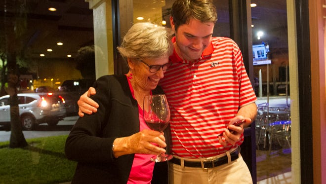 Cathleen Morgan and Ryan White celebrate her win over Chris Quackenbush for Lee County School Board on Tuesday, November 8, 2016.
