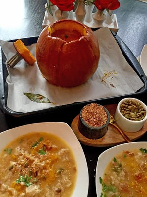 To serve this baked soup, gently scoop a big spoonful of flesh from inside the pumpkin into each bowl and ladle the cheesy stock over.