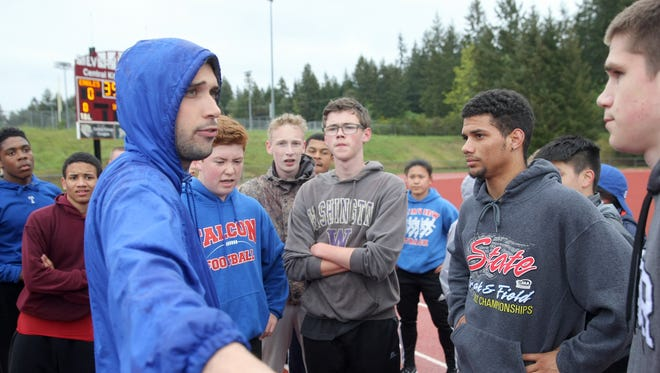 Olympic track and field coach Travis Quinn (left) has been hired to coach the Trojans' cross country program.