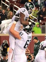Michigan State running back L.J. Scott (3) celebrates
