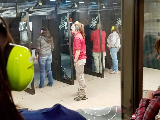 Reno firearms instructor Alisha Ketter watches as students