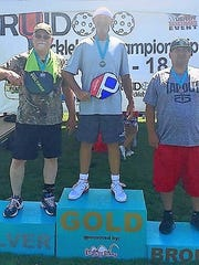 Three of the pickleball tournament winners pose with