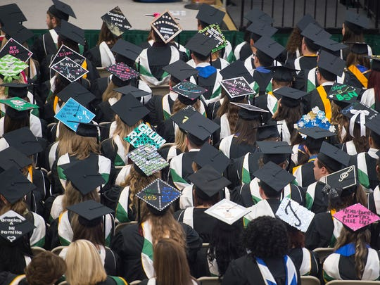 Self-styled caps were plentiful during the York College graduation.