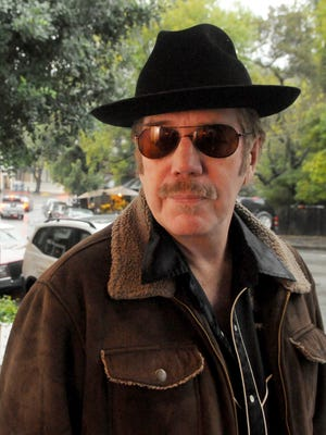 In this March 16, 2012 photo, singer Dan Hicks poses for a photo in Mill Valley, Calif. Hicks, the longtime leader of Dan Hicks and the Hot Licks band, has died after a two-year battle with cancer. He was 74. Hicks'' wife says the veteran San Francisco Bay Area singer, songwriter and band leader died Saturday, Feb. 6, 2016.