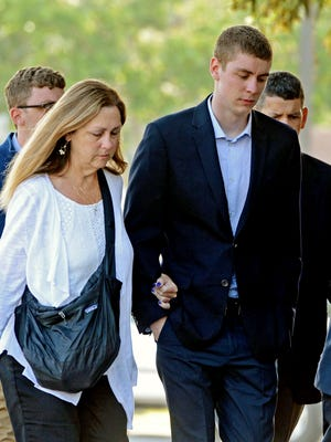 In this June 2, 2016 file photo, Brock Turner, right, makes his way into the Santa Clara Superior Courthouse in Palo Alto, Calif.