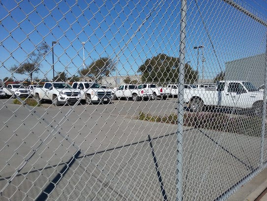 More than 35 extended cab pickup trucks were parked at the Monterey County Agricultural Office.
