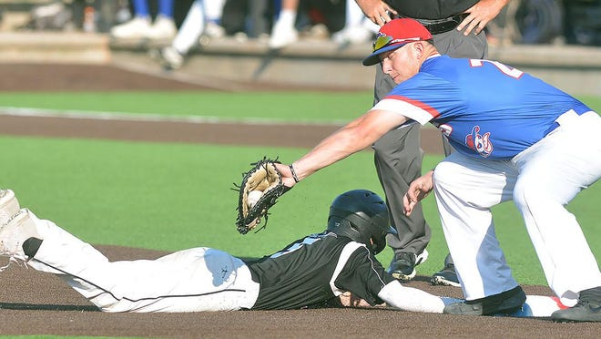 Hays first baseman Corbin Truslow tries to get the tag down of Cheney's Andrew Stewart during play Thursday at Eck Stadium.